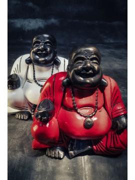 Buda sonriente en actitud que se sienta